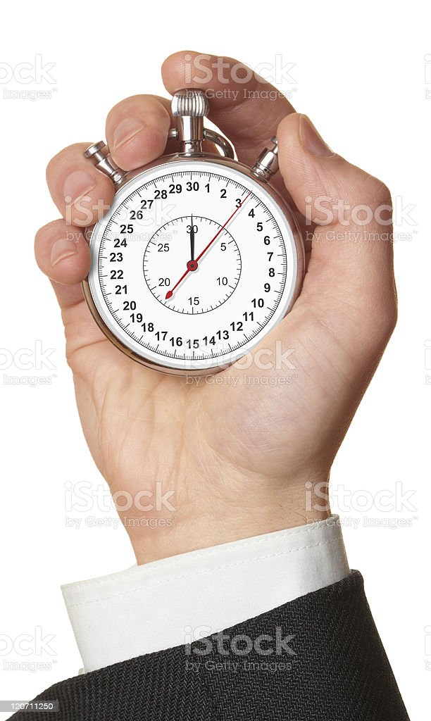 Man's hand holding stopwatch. royalty-free stock photo