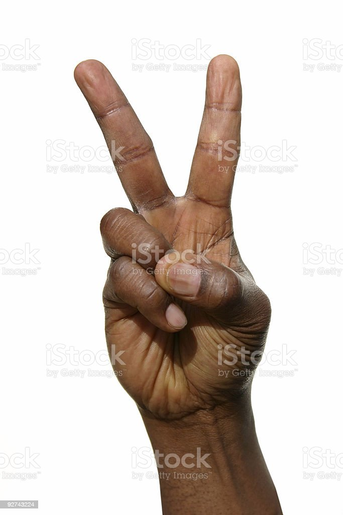 Man's hand in a fist with pointer and middle finger up stock photo