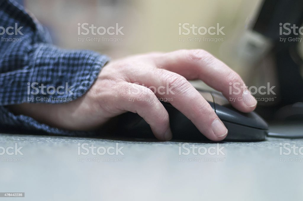 Man's Hand on Computer Mouse, Closeup royalty-free stock photo