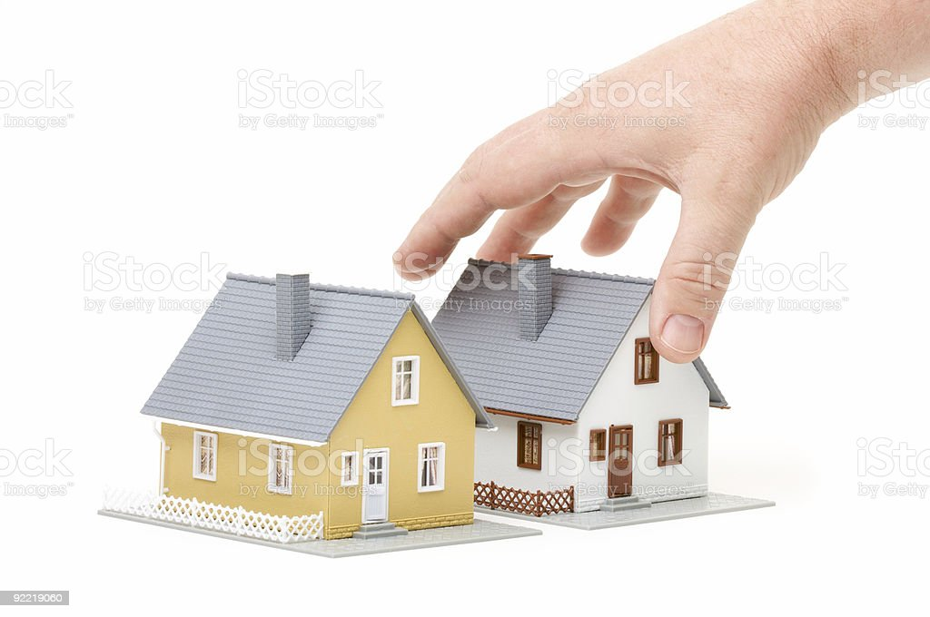 Mans Hand Picking Up Small Model Home on White royalty-free stock photo