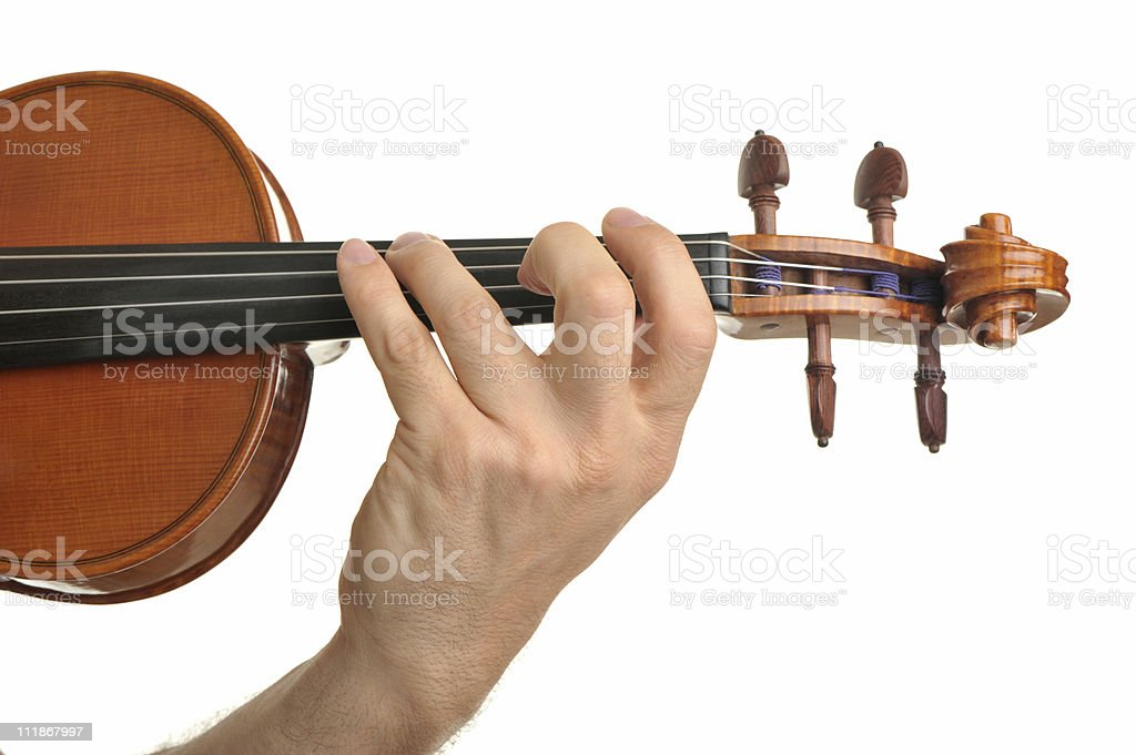Man's Hand Playing Violin with Rosewood Tuning Pegs on White stock photo