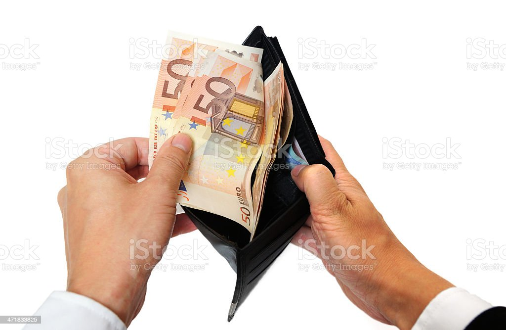 man's hand pulling cash from the wallet royalty-free stock photo