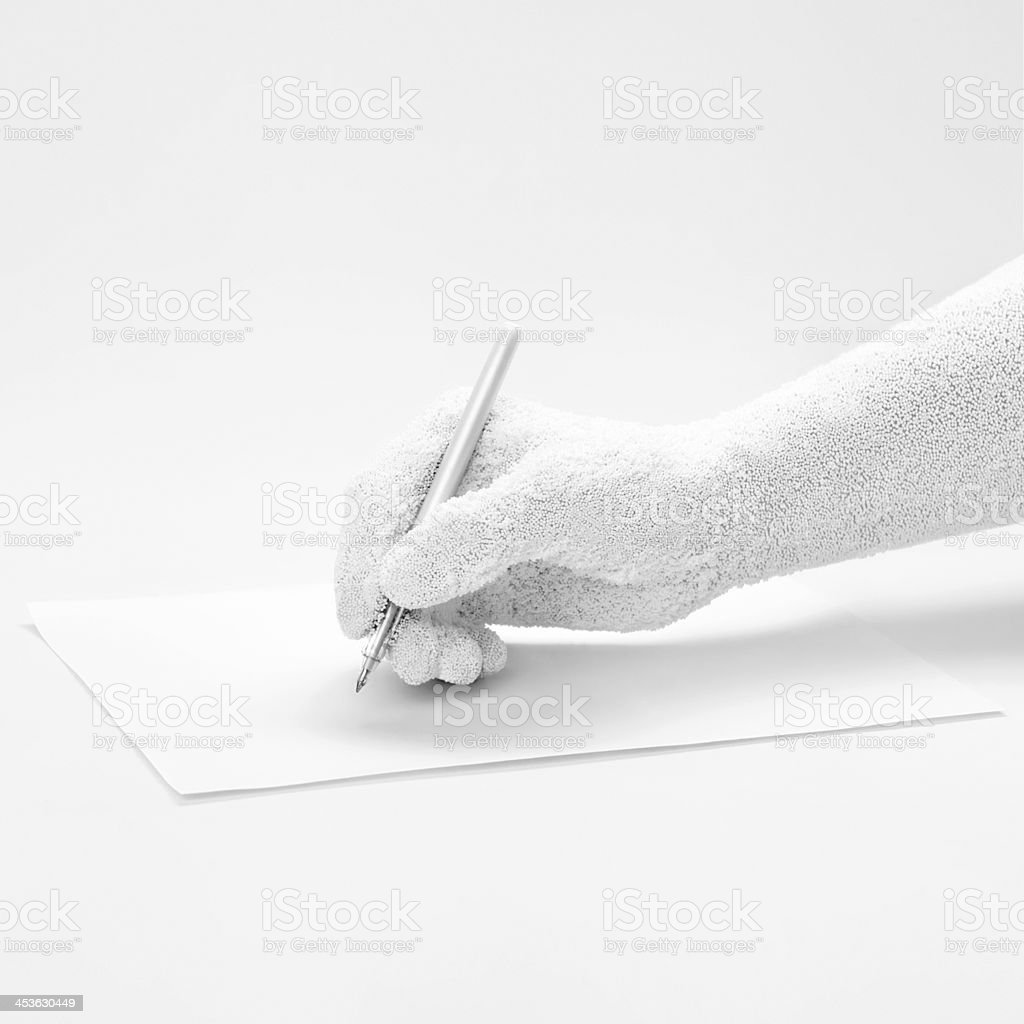 man's hand ready to sign with a white feather. stock photo