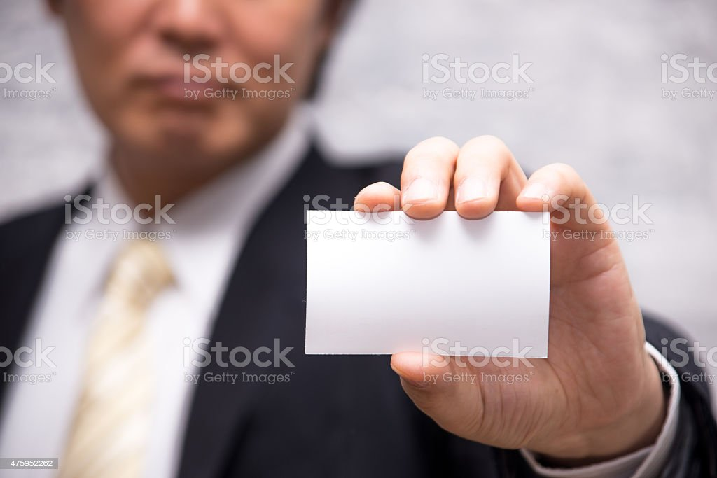 Man's hand showing business card stock photo