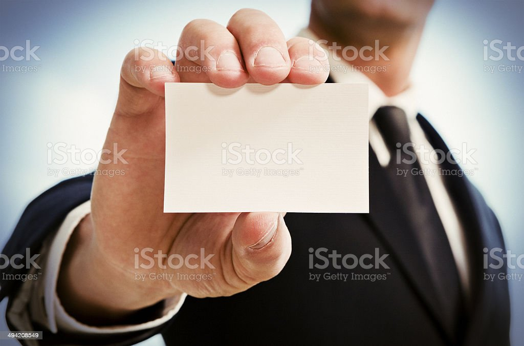 Man's hand showing business card. stock photo