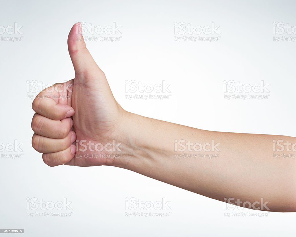 mans hand showing close up of the thumbs up sign stock photo