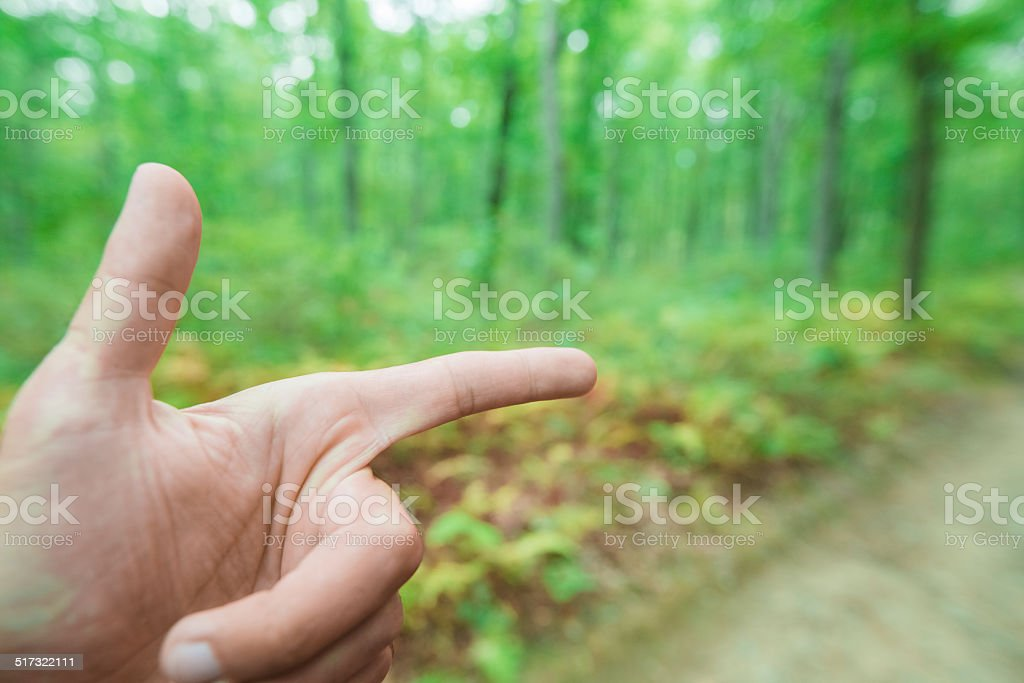 Man's hand shows the direction stock photo