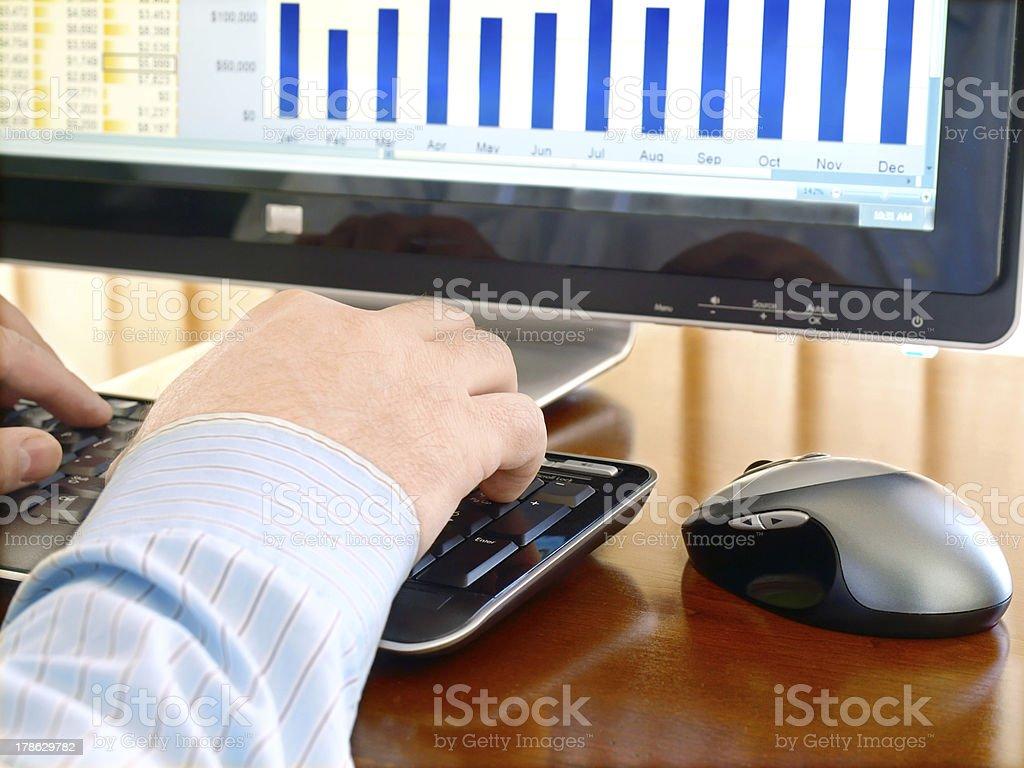 Man's Hand Typing at a Computer Keyboard royalty-free stock photo
