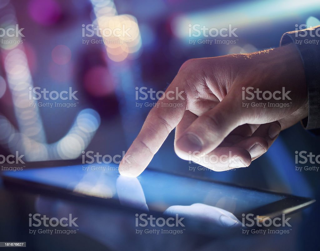 A mans hand using a digital tablet royalty-free stock photo