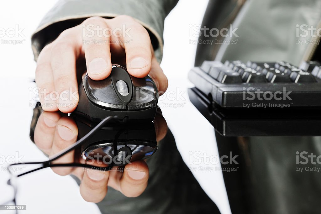 Man's hand using computer mouse on shiny reflective surface royalty-free stock photo