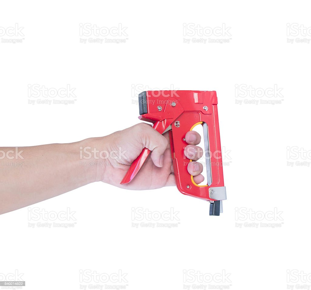 Man's hand with a red stapler isolated on white stock photo