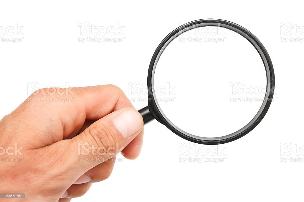 Man's hand with magnifying glass. stock photo