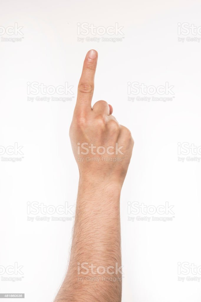 Man's hand with the index finger stock photo
