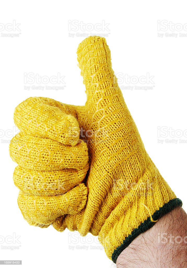 Mans Hand With Thumb Up In Yellow Work Glove stock photo