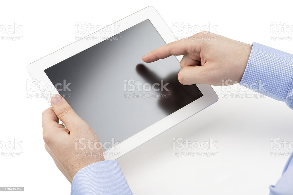 Man's hands are holding tablet computer and points at screen. stock photo