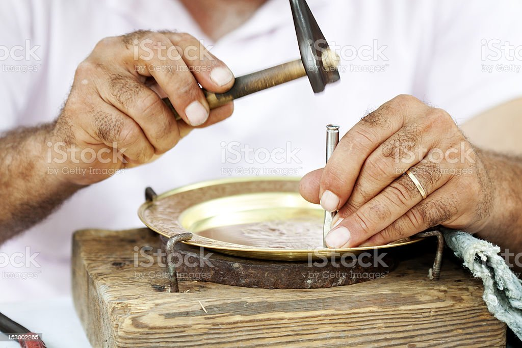 Man's hands decorating plate stock photo