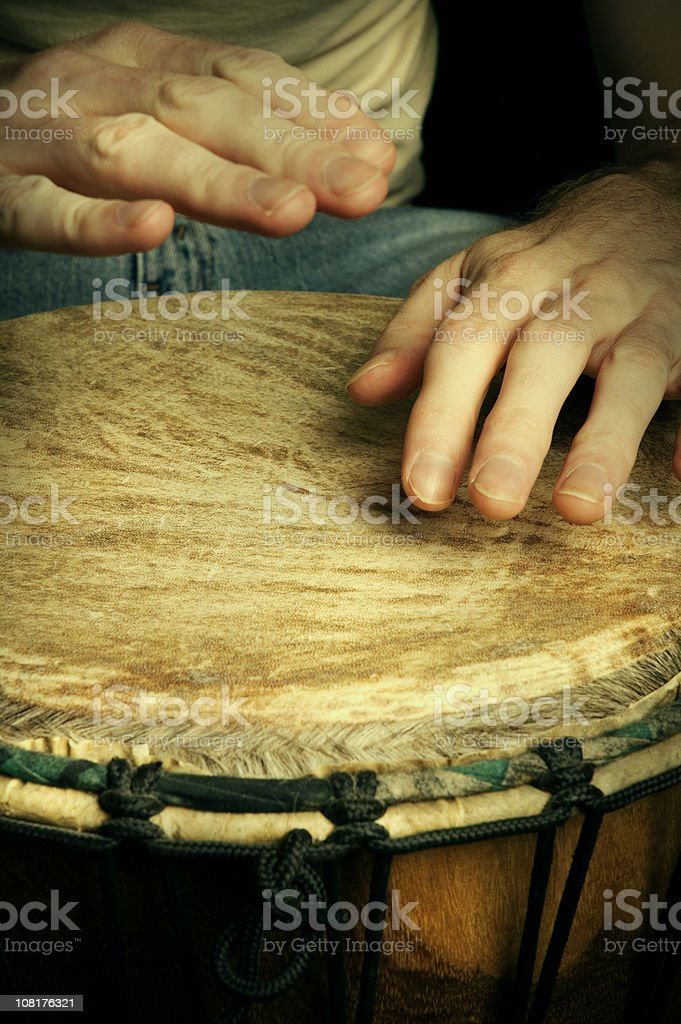 Man's Hands Drumming on Bongo Drum royalty-free stock photo