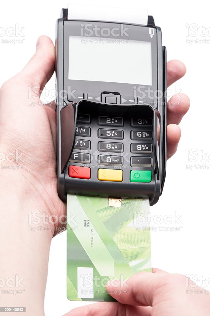 Man's hands holding a bank card on POS-terminal stock photo