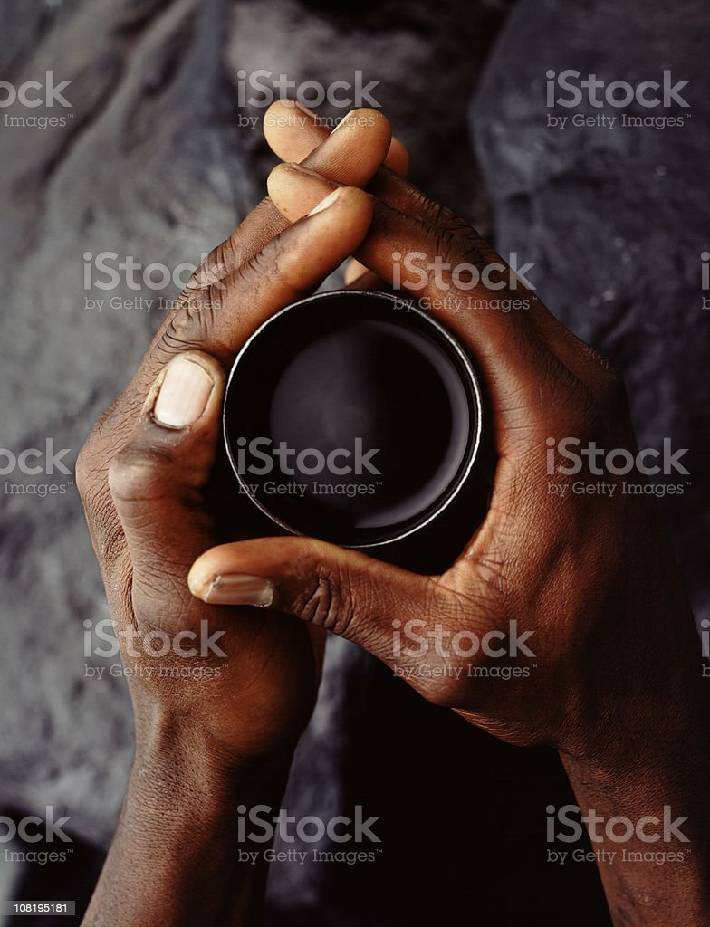 Man's Hands Holding Cup of Black Coffee stock photo