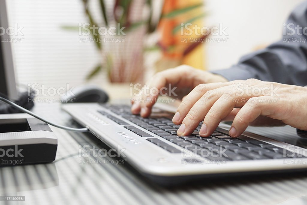 Man's hands on a keyboard stock photo