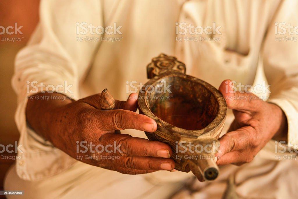 Man's Hands Preparing Opium, Salawas Village, India stock photo