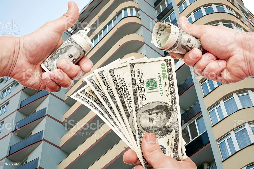 Man's Hands with notes of US dollars stock photo