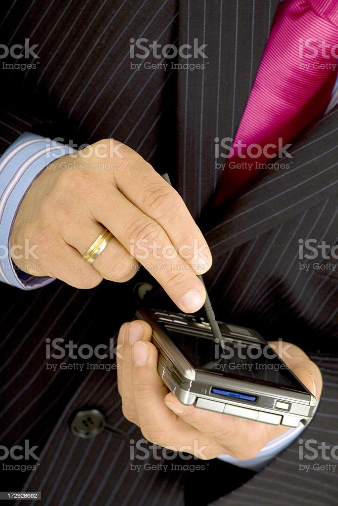 Man's hands with PDA royalty-free stock photo