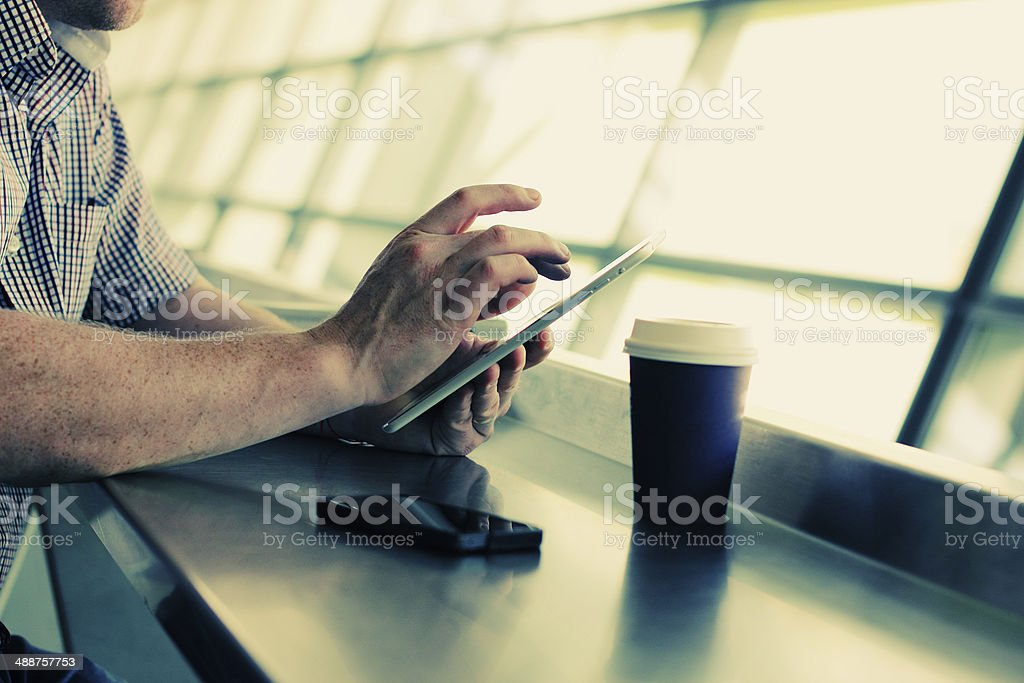 man's hands with tablet stock photo