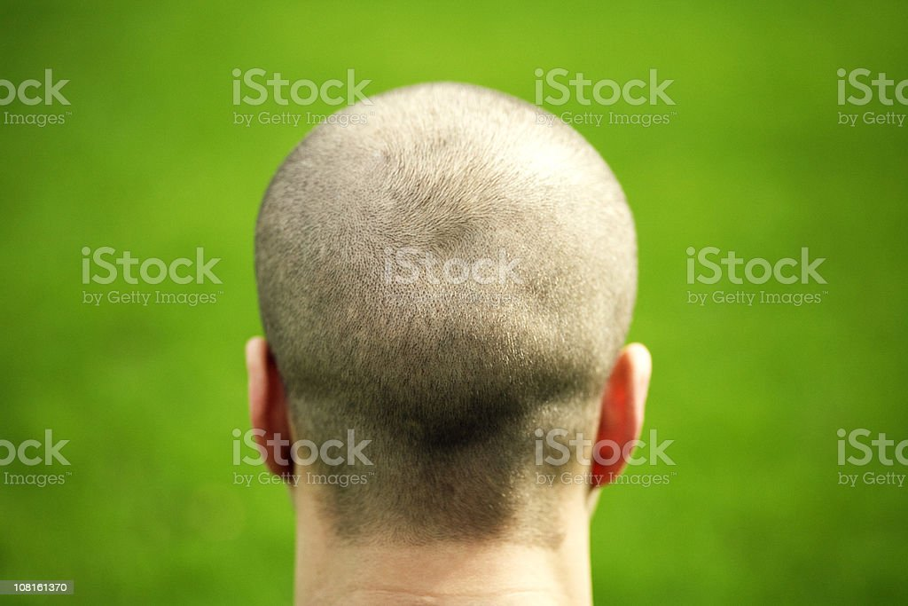 Man's Head from Behind on Green Background royalty-free stock photo