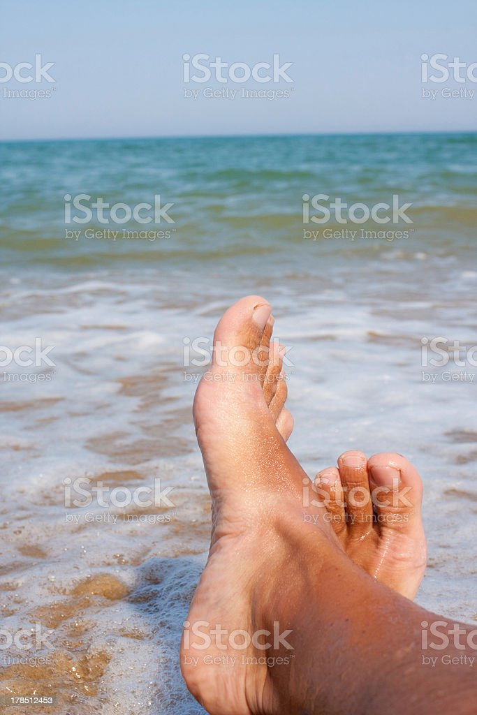 man's legs on the sand beach royalty-free stock photo