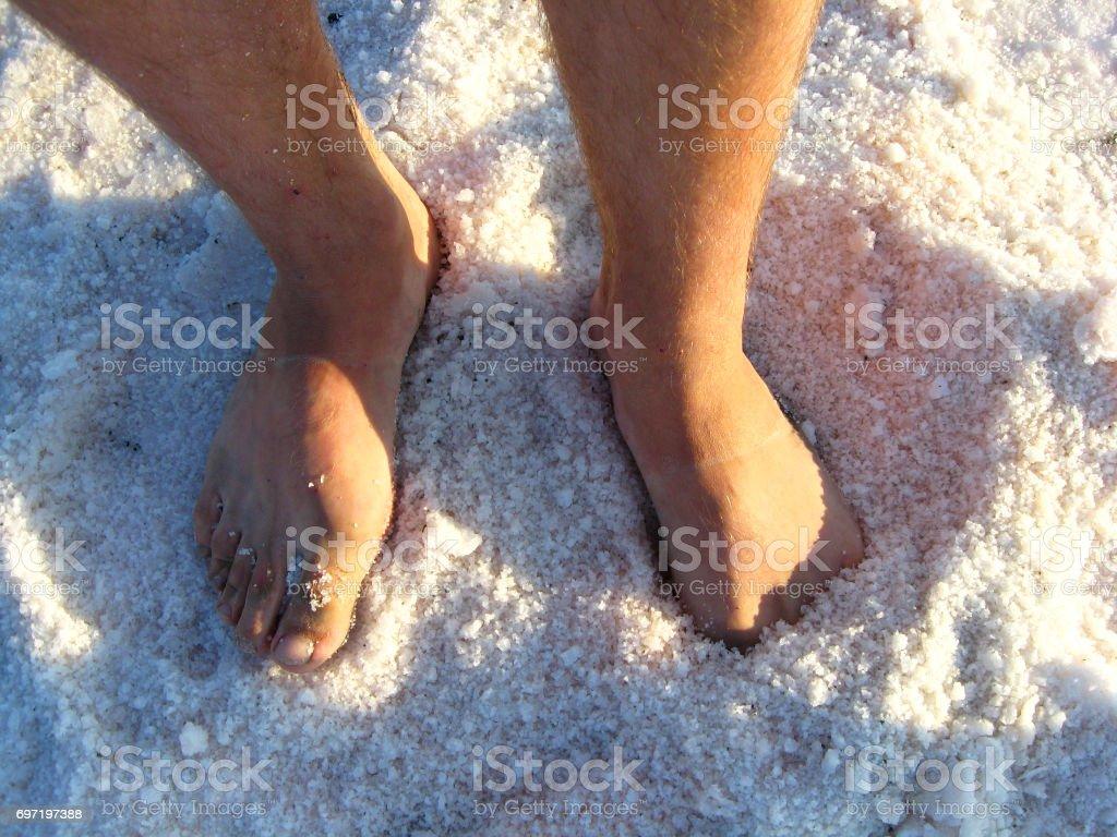 man's legs standing in the healing salt stock photo