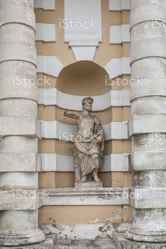 man's monument between columns stock photo
