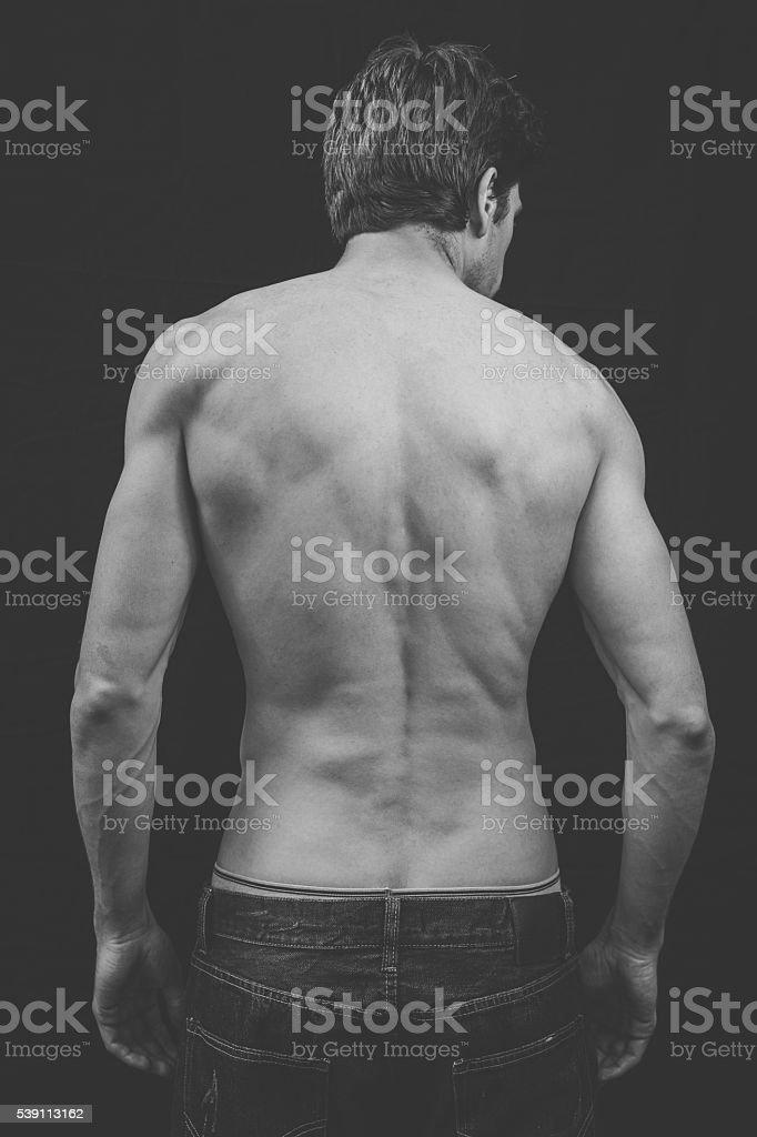Man's musclar back stock photo