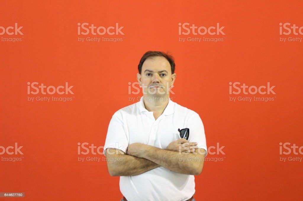Man`s portrait. Orange wall. stock photo