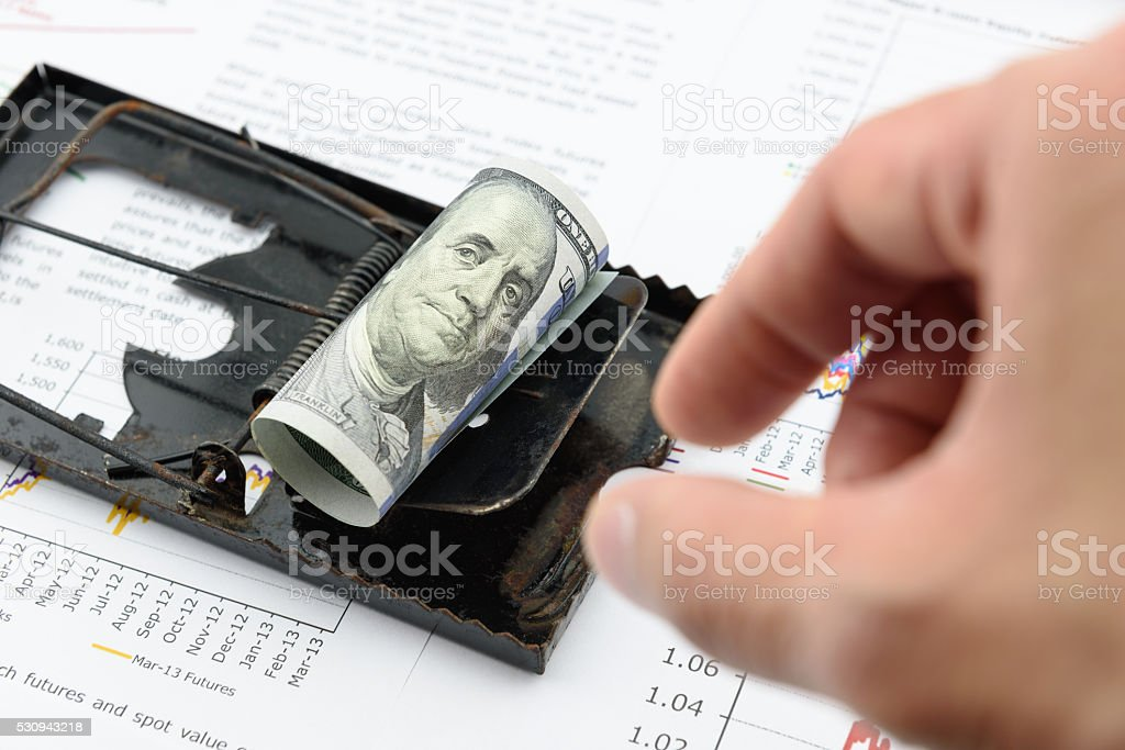 Man's right hand is preparing to pick US dollar bill stock photo