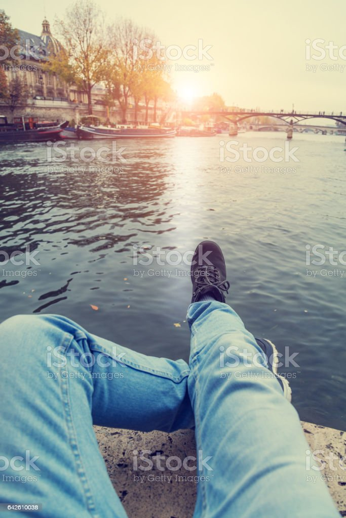 Man's shoes on the Seine river in Paris, pont Neuf. stock photo