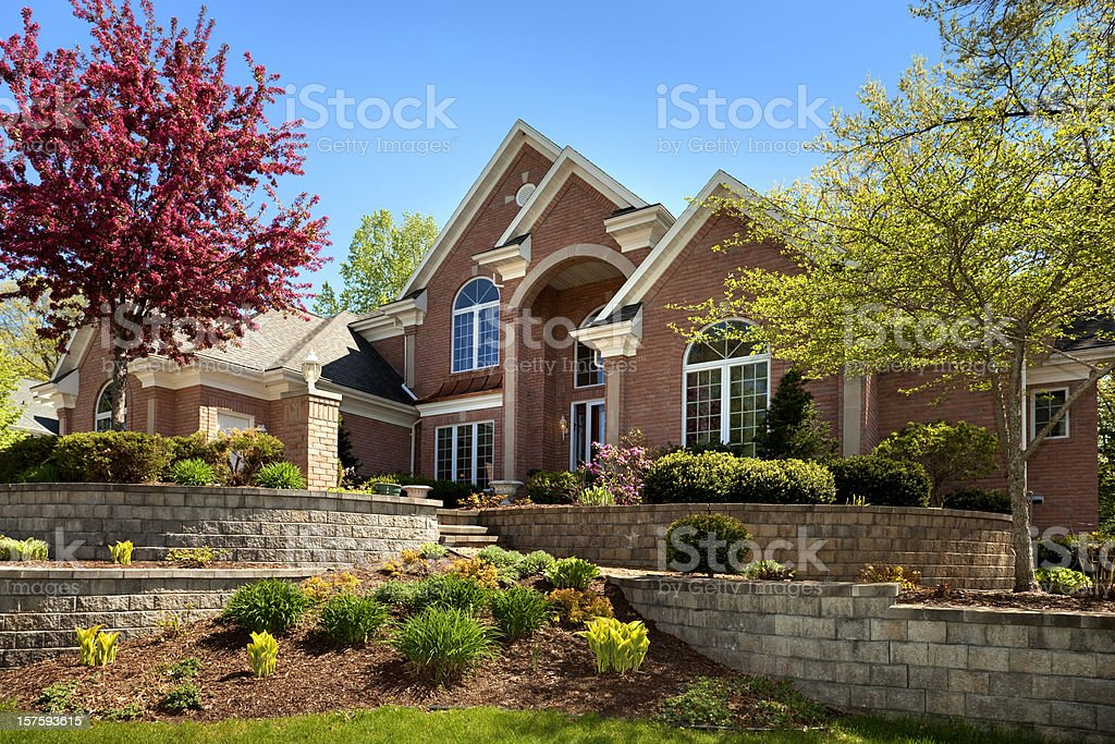 Mansion Home Exterior Design; Terraced Paved Landscape, Colorful Spring Foliage stock photo