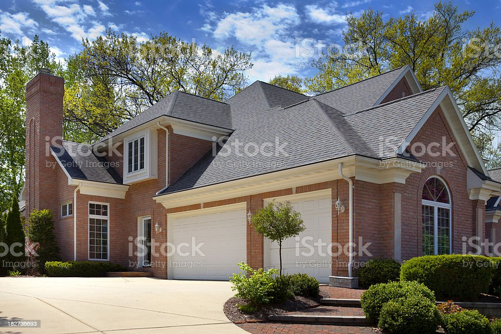 Mansion Home Exterior; Terraced Paved Landscaping, Colorful Spring Foliage royalty-free stock photo