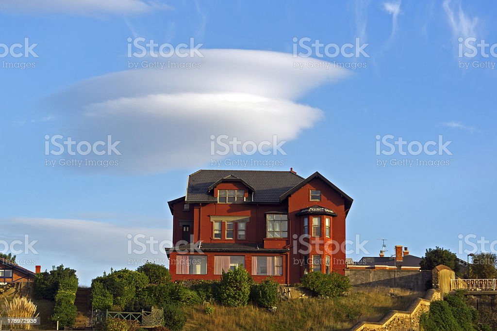 mansion in Getxo with a lenticular cloud royalty-free stock photo