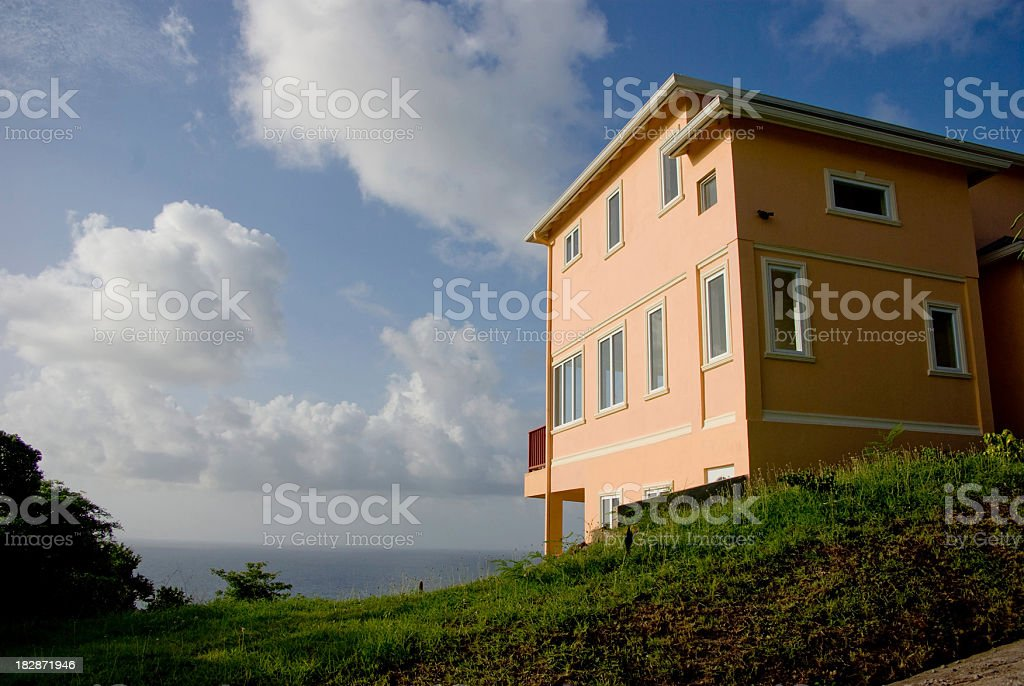 mansion overlooking sea royalty-free stock photo