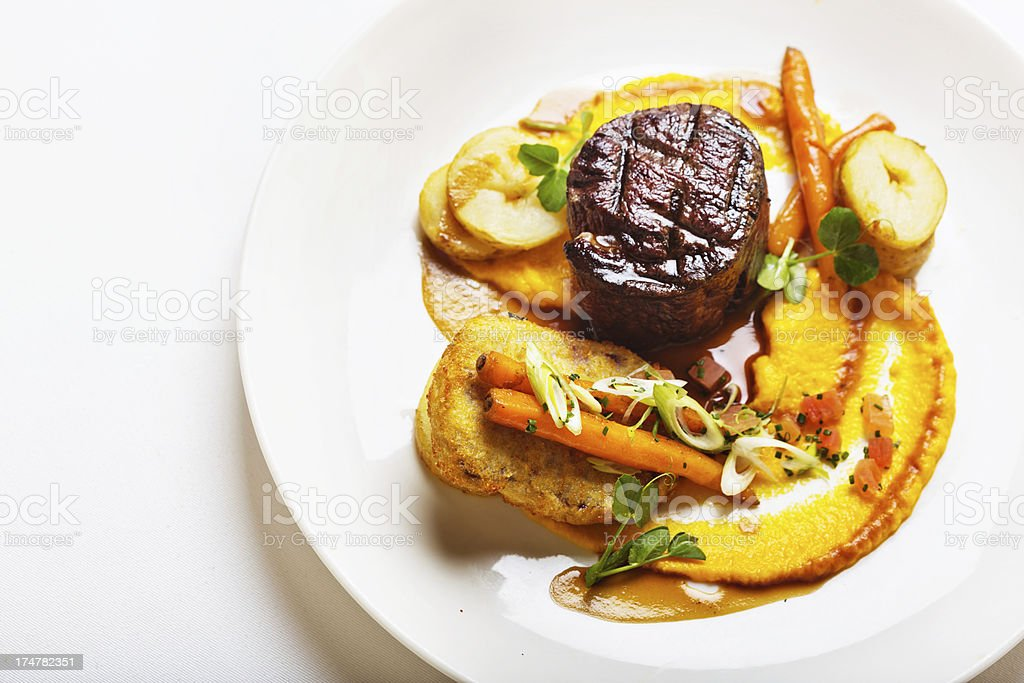 Man-size and delicious gourmet restaurant meal of steak with vegetables stock photo