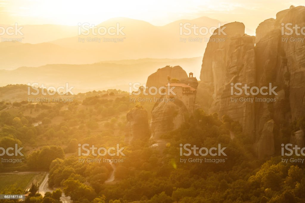 Manstery in golden sunset rays, Meteora, Greece stock photo