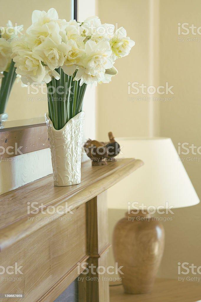 mantelshelf with narcissi royalty-free stock photo