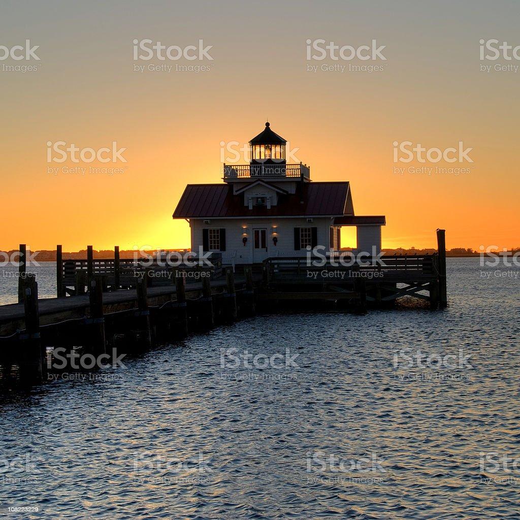Manteo Lighthouse on Dock at Sunrise stock photo