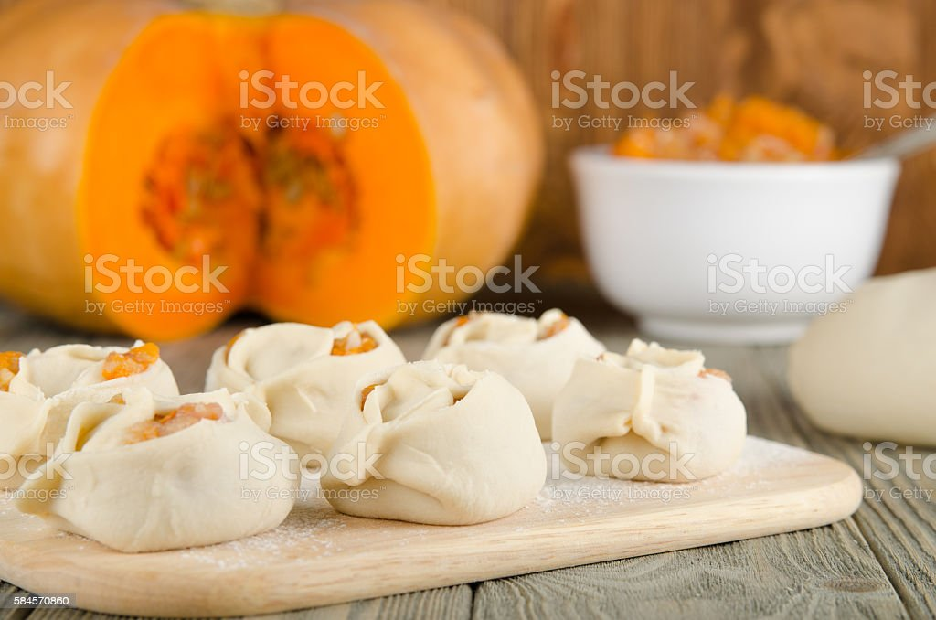 Manti. Asian national dish with meat and pumpkin on rustick stock photo