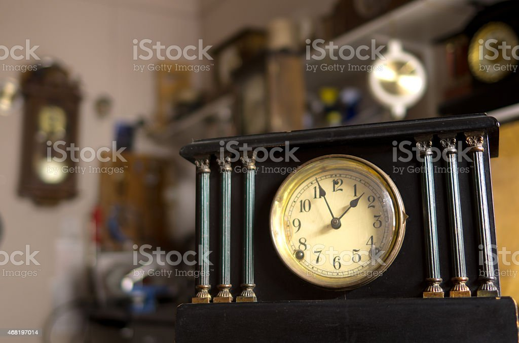 Mantle Clock in a Room Full of Timepieces stock photo