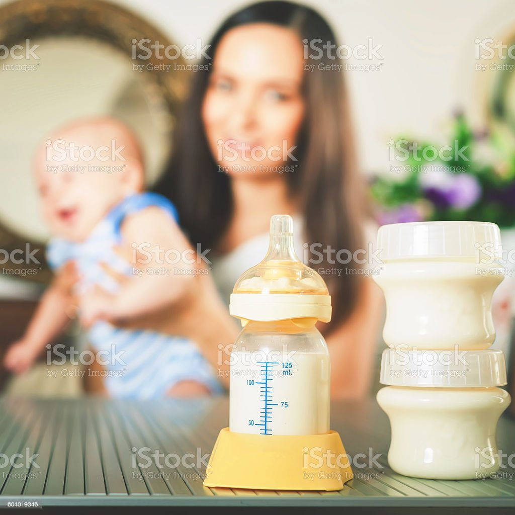 Manual breast pump, mothers breast milk stock photo