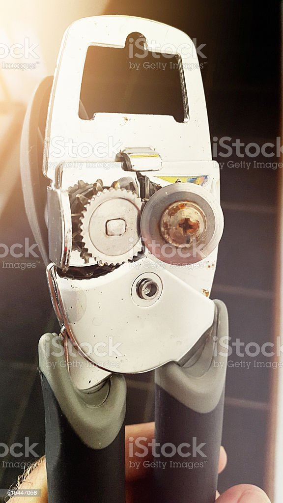 Manual can opener seen from beneath stock photo