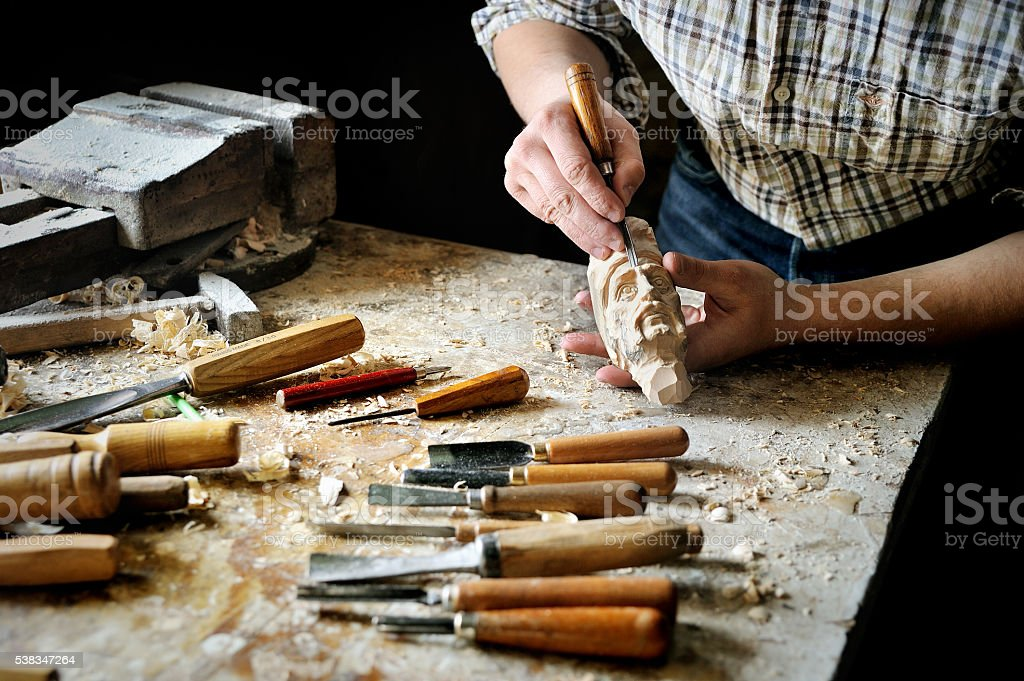 Manual carve with cutter tools stock photo