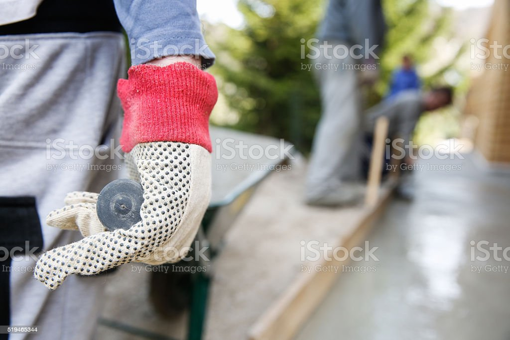 Manual construction worker driving wheel barrow stock photo